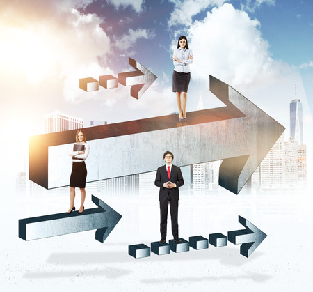 growing partnership: Success concept with businesspeople on grey arrows with sunlit city in the background Stock Photo