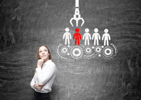 Human resources management and choice concept with thoughtful businesswoman and sketch on chalkboard background Stock fotó - 57409022