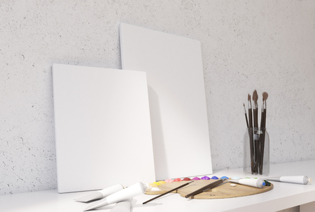 blank canvas: Two blank canvas, oil paint palette and brushes on white desktop and concrete wall background. Mock up, 3D Rendering