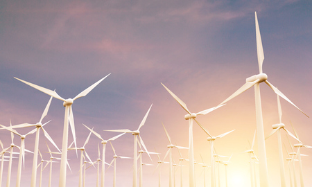 spinning windmill: Numerous wind mills in the sky at sunset. 3D Rendering
