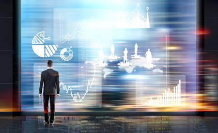 puzzle background: Businessman looking at abstract business chart and puzzle pieces with people silhouettes on blurry city background. Concept of business management and teamwork