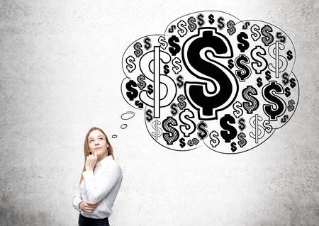 signos de pesos: Pareja atractiva de negocios pensando en el crecimiento económico y la riqueza en el fondo de hormigón con bosquejo