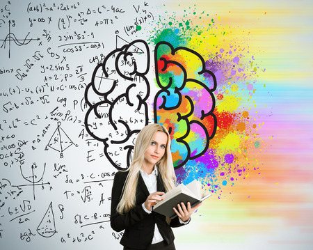 analytical: Right and left hemispheres, creative and analytical thinking concept with businesswoman holding book on background divided into colorful and mathematical formula walls