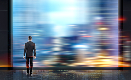 thoughful: Thoughful businessman in interior looking at blank blurry transparent screen on night city background
