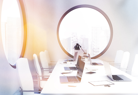 singapore city: Side view of concrete conference room interior with round windows and Singapore city view. Toned image. 3D Rendering Stock Photo