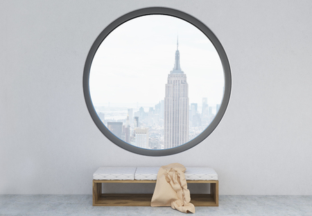 round window: Concrete interior with blanket on bench and round window with New York city view. 3D Rendering