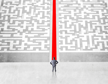 cut through the maze: Success concept with businessman and red path groing through maze on concrete ground Stock Photo