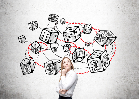 economic theory: Thoughtful businesswoman standing against concrete wall with connected dice sketch. Game and probability theory