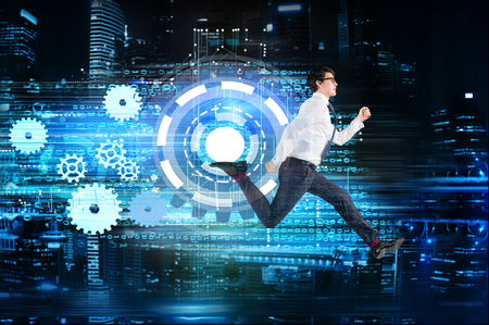 computerization: Success and progress concept with running businessman and digital cogwheel trail on night Singapore city background