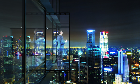 penthouse: Businessman with coffee cup looking into the distance from empty balcony interior on Singapore city background at night. 3D Rendering Stock Photo