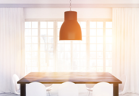 kitchen window: Ceiling lamp, wooden kitchen table and white chairs in front of window with curtains and city view. Toned image. 3D Rendering