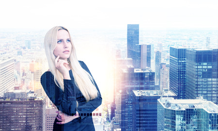 double chin: Thoughtful businesswoman on New York city background with sunlight. Double exposure
