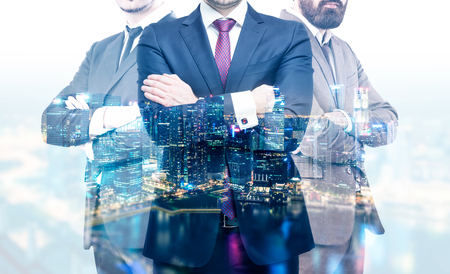 crossing arms: Teamwork concept with businesspeople crossing arms on night Singapore city background. Double exposure
