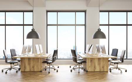 office computer: Front view of coworking office interior with computer monitors on wooden desks, parquet flooring, concrete walls and panoramic windows with city view. 3D Rendering