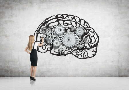 business education: Businesswoman drawing abstract brain with metal gears on concrete wall in room. Brainstorming concept
