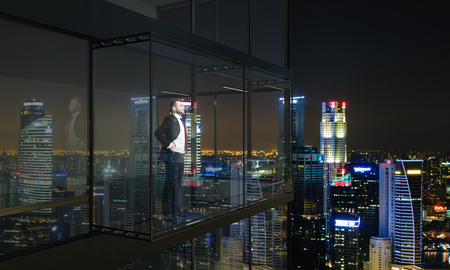 penthouse: Thoughtful businessman looking into the distance from empty balcony interior on Singapore city background at night. 3D Rendering