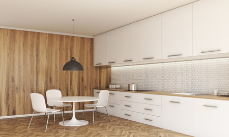 small lamp: Side view of kitchen interior with small dining table and chairs, counter with stove and sink, cabinets, ceiling lamp, wooden floor and wall. 3D Rendering Stock Photo