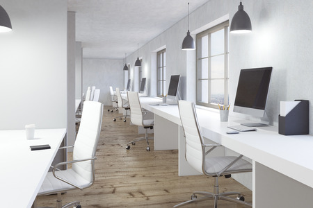 office window view: Coworking office interior with wooden floor, white desks, blank computer monitors and window with city view. 3D Rendering