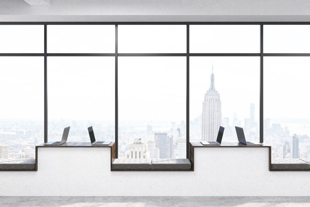 windowsill: Front view of modern hipster windowsill workplaces with laptops in concrete interior with panoramic window and New York city view. 3D Rendering