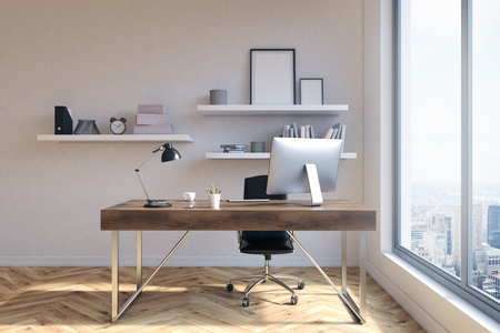 picure: Front view of office workplace with blank picure frames on shelves, desk with computer and other items, wooden floor, concrete wall and window with New York city view. 3D Rendering Stock Photo