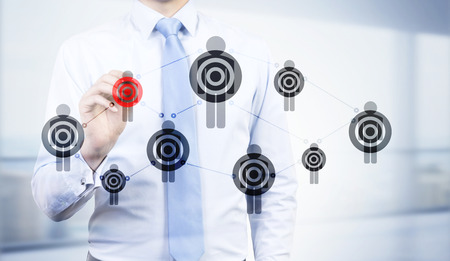 targeting: Targeting concept with businessman drawing red dartboard on human icon network