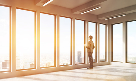empty office: Man in empty office watching at city through big windows. Abstract. Concept of decision making. 3D render. Toned image.