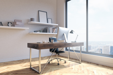 picure: Side view of office workplace with blank picure frames on shelves, desk with computer and other items, wooden floor, concrete wall and window with New York city view. 3D Rendering