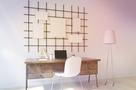 toned: Cosy home office with laptop, stylish furniture and posters on wall. Concept of study. 3D render. Mock up. Toned image Stock Photo