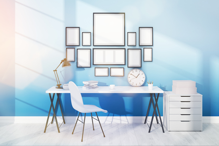 great work: Great work space with posters on light blue wall, a set of drawers, a table and office chair. 3D render. Mock up Stock Photo