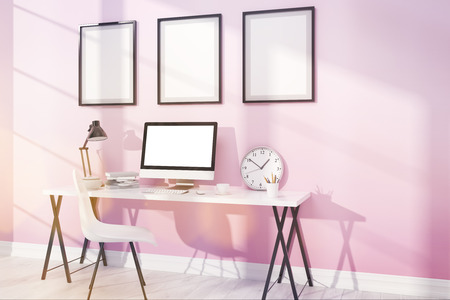 study table: Modern and comfortable study with posters on pink wall. Computer on table and big clock.