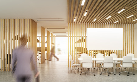 Blurry Businesspeople In Open Office Interior With Wooden Partitions,sunlight  And Meeting Area With Blank
