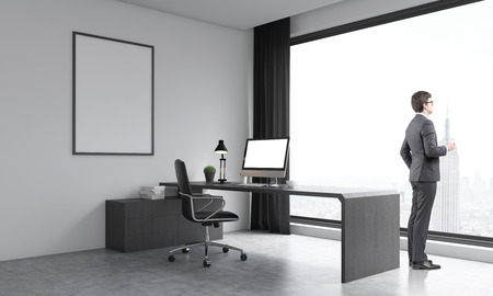wooden work: Businessman in suit watching at city through large window. Poster on office wall. Computer on wooden table. Concept of work and deep thinking. 3D render. Mock up. Stock Photo
