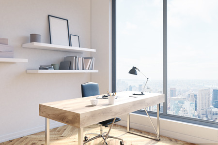 picure: Side view of office workplace with blank picure frames on shelves, desk with coffee cup and other items, wooden floor, concrete wall and window with New York city view. 3D Rendering