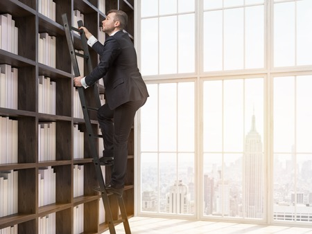 toning: Young man in suit is climbing up ladder in house library. New York city seen through window. Concept of information searching. 3d rendering.