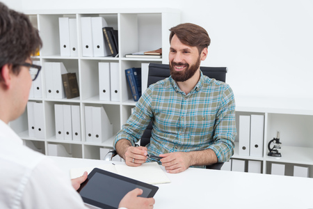 One man interviewing young engineer for work. Concept of job interview.