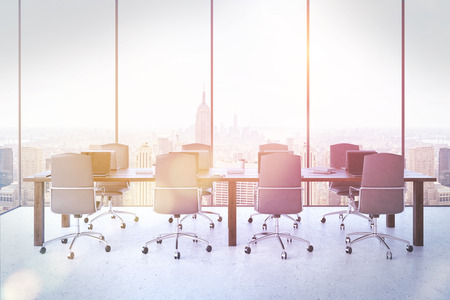 massive: Conference room interior in our days New York City. Massive tables with laptops. Comfortable leather chairs. Bright sun shining. Concept of board meeting. 3d rendering. Toned image.