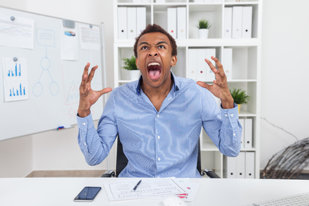 rage: Man shouting in uncontrolled rage attack. Concept of anger management importance Stock Photo