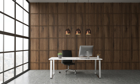 Interior with desk in front of wooden wall in office room. Three ceiling lamps hanging above it. Big computer monitor on table. Concept of effective working. 3d rendering. Stock Photo