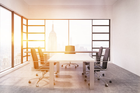 panoramic business: Board room interior. New York. Bright sunlight. Concrete floor. Panoramic windows. Concept of successful business Stock Photo