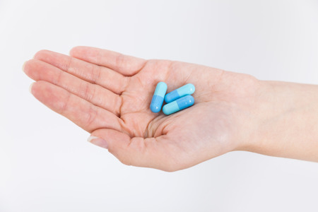 Woman hand with pills. Concept of health and illness Stock Photo