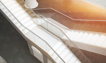 stairs interior: Building interior. Two flights of stairs. Sun shining through window. White column in background. Concept of success and luck in business. 3d rendering. Top view.