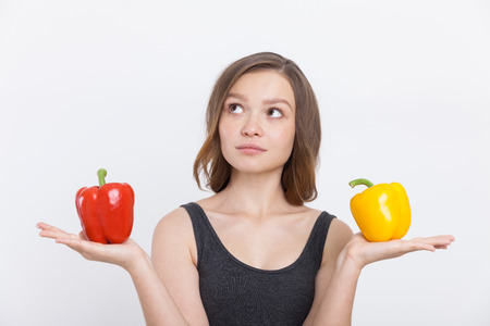 way of thinking: Girl with bell peppers thinking about healthy diet and clean way of life. Concept of health