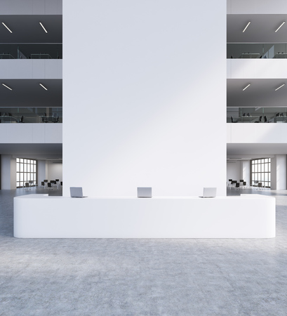 large: Reception in large office building. White wall. Computers on desk. Other rooms in background. 3d rendering. Mock up Stock Photo