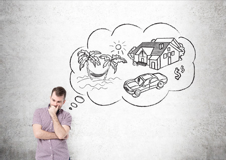Man in shirt dreaming about vacation in front of concrete wall. Thought bubble with sketch of travelling. Concept of planning Фото со стока