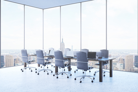 conduction: Conference room in modern New York City with large table and comfortable armchairs around it. Laptops on desk. Concept of business meeting conduction. 3d rendering.