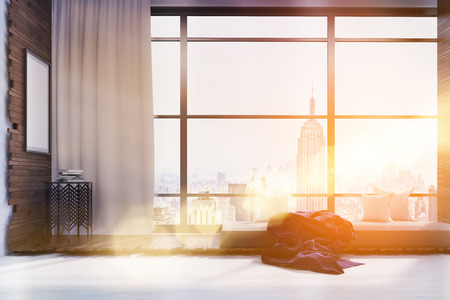 toned: New York city view as seen from living room window in skyscraper. Coffee table under large poster. Broad bed with pillows and blanket. Sunlight. Concept of rest at home. 3d rendering. Mock up. Toned image