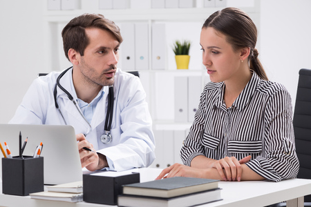 medical attention: Patient and doctor talk about illness symptoms. Concept of good medical care and attention Stock Photo