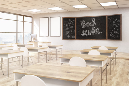 school classroom: School classroom interior. Blackboard and posters on wall, plastic chairs, wooden desks. Concept of good education. Back to School. 3d rendering. Mock up