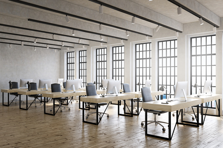 wooden work: Large office room with lots of computer desks and big windows. Wooden floor. Good lightning. Concept of corporate work. 3d rendering Stock Photo