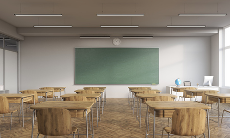 wooden furniture: Classroom interior with wooden furniture. Globe on teachers desk. Computer. Stock Photo